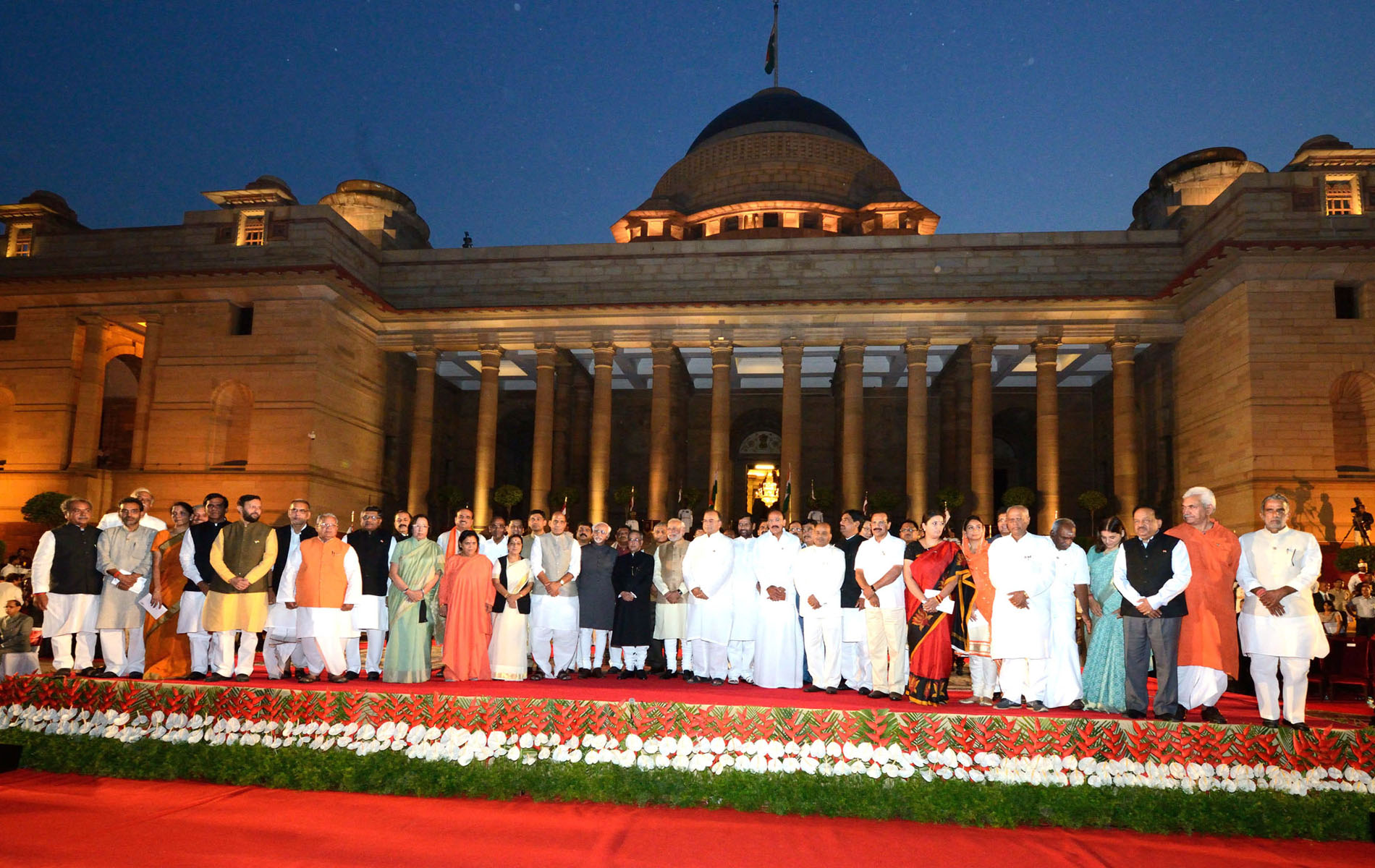 Prime Minister Narendra Modi and his ministers pose with President Pranab Mukherjee and Vice President Hamid Ansari after the swearing-in
