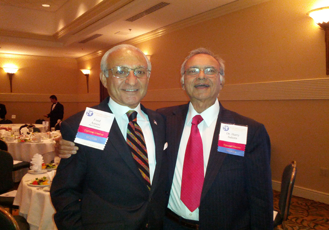 Dr Harvinder Sahota (right)