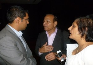 Host and organizer Sanjay Agnihotri (extreme left) in conversation with journalists Ajit Jain and Renu Mehta