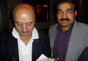 Indo-Canada Chamber of Commerce president Naval Bajaj getting his book signed by the actor