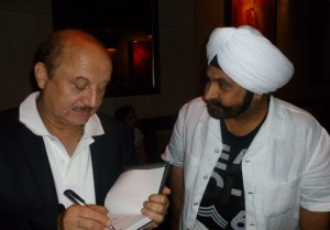 Kher signing the book for Nav Bhatia who is a top Hyudai dealer in Canada