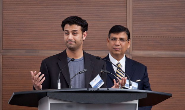 Suresh Madan (in the background) seen with entrepreneur Haroon Mirza whom TiE Toronto mentored to success.