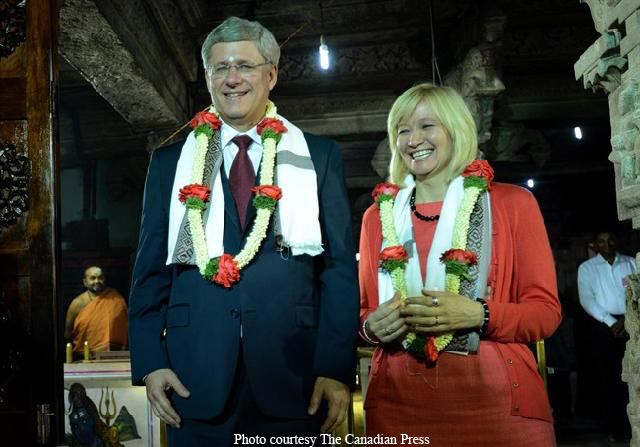 `We are married again,' jokes Harper as temple priest asks the PM to garland his wife