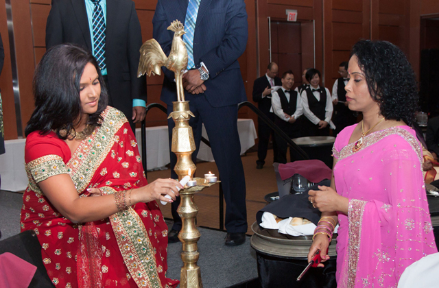NDP MP Rathika Sitasabieasan lighting the lamp