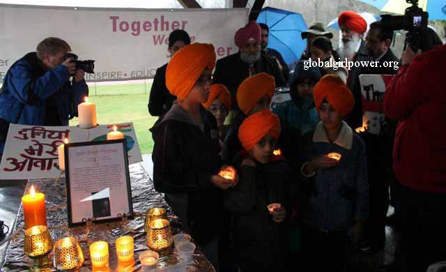 Sikh boys hold candles for sister Jyoti