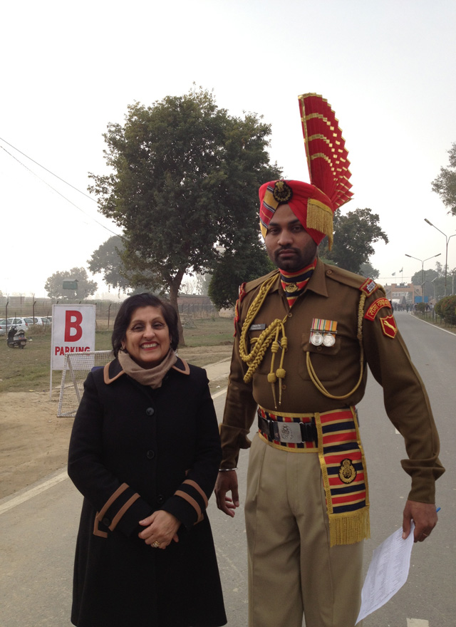 Renu Mehta poses with an Indian solider