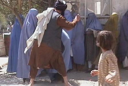 Taliban beat a woman