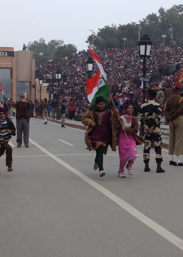 Two girls carry the Indian flag before the ceremony.