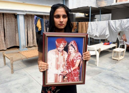 Deserted bride of Punjab with the photo of her missing NRI groom