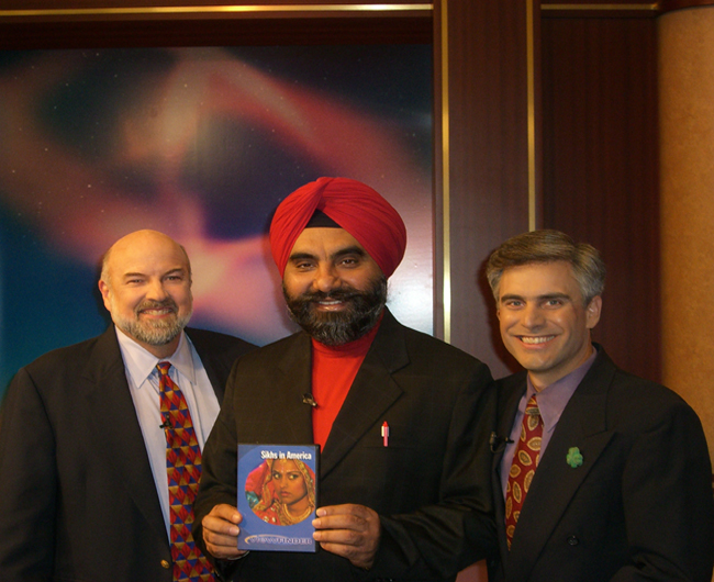 Dr Jasbir Kang at KVIE Studios with a copy of the documentary SIKHS IN AMERICA which won an Emmy award. The Punjabi community of Yuba City helped KVIE to produce the documentary.