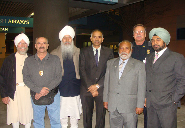 MSS Hari Singh Khalsa, Marshall Katz, Bhai Sahib Satpal, Mr. Keval Dhindsa and Pawan Singh Dhindsa with Indian Consul  General Parvathaneni Harish at Albuquerque Airport in New Mexico.