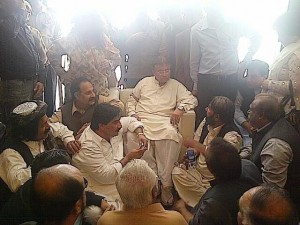 Musharraf with his party workers on his landing in Karachi