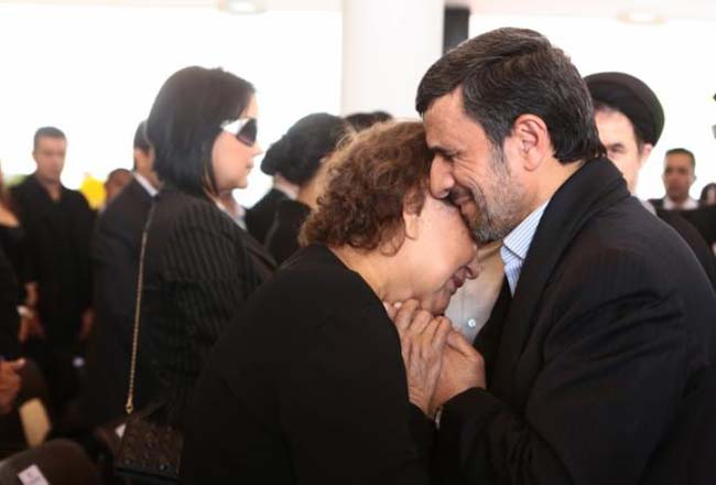 Ahmadinejad consoling Hugo Chavez's mother