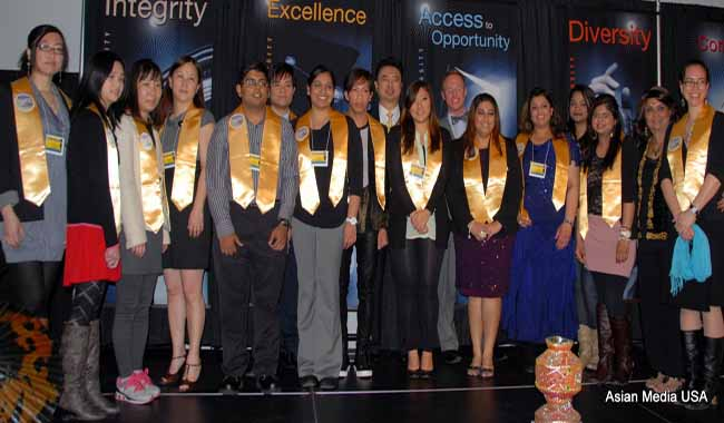 Graduating students of Dec. 2012 and May 2013 felicitated with yellow sashes.