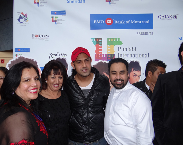 Actor Gippy Grewal (red cap) poses with hotelier Harpreet Sethi (to Gippy's left) and others.