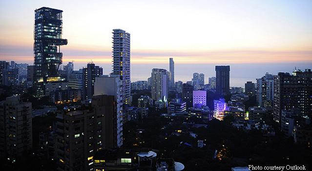 Antilla, Mukesh Ambani's billion-dollar house in Mumbai, is at the left