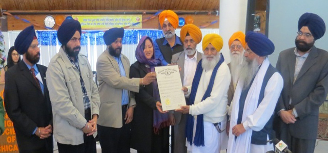 Sikhs being presented the Illinois Governor's proclamation to declare Vaisakhi day as `Sikh American Heritage Day'