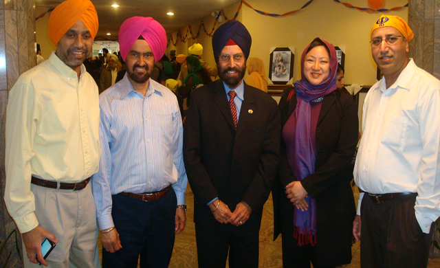 Sikhs with Ms Teresa Mah, the Governor's Senior Policy Advisor.