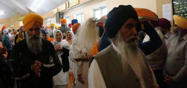 Sikhs carrying the holy Guru Granth Sahib as part of Vaisakhi celebrations in Chicago.