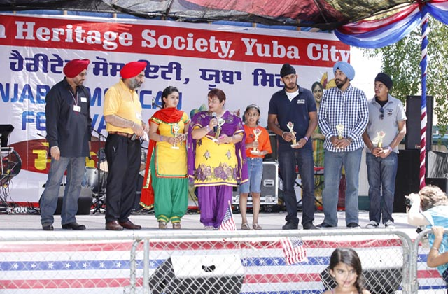 Seva Group members, who have organized 13,000 meals for the needy in one year, being honored for their selfless service