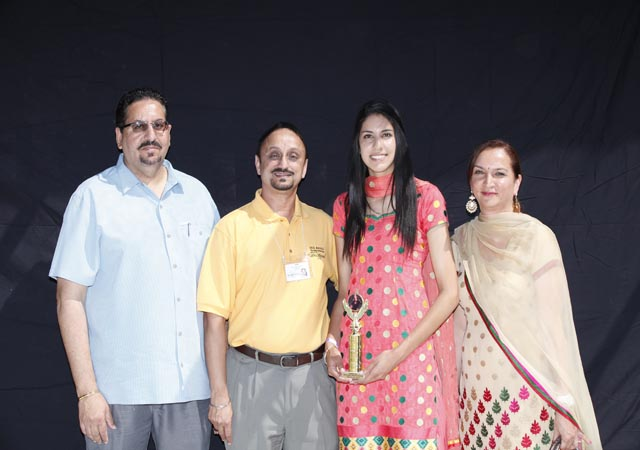 Volleyball national player Sumeet Kaur Gill (second from right) posing with her parents after being honored by PAHS