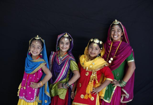 Young kids performing in traditional Punjabi costume