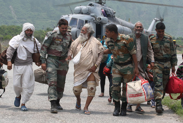 Pilgrims rescued from Harsil arrive at Dharasu, Uttarakhand.