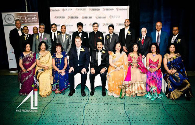Minister John Baird (sitting 4th from L), Naval Bajaj, ICCC president (5th from L) with award winners and ICCC Board Members. Photo and caption by Irfan Ali