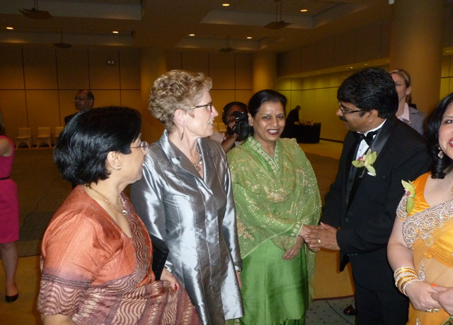 Ontario Premier Kathleen Wynne with MPP Amrit Mangat (in green Punjabi suit), former ICCC presidents Asha Luthra (extreme left) and Satish Thakkar.