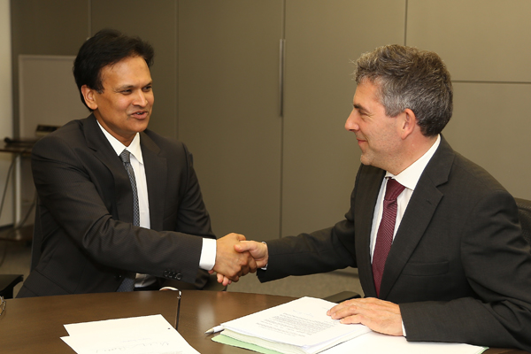 Sanjeev Kanoria (left) sealing the bank deal