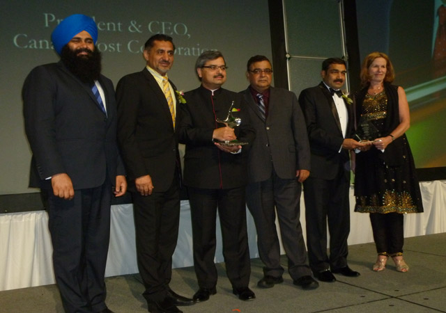 Tim Uppal, Bal Gosal, Deepak Obhrai and ICCC president Naval Bajaj seen with Canada Post CEO Deepak Chopra after he was given the Corporate Executive award