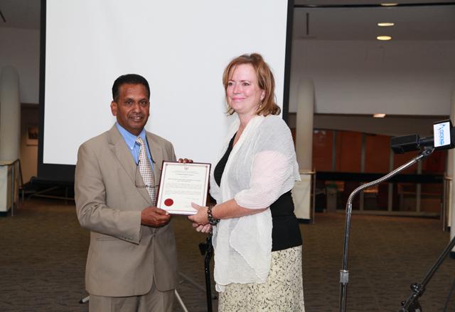 Tracy MacCharles with Canadian Tamil Congress president Raj Thavaratnasingam.