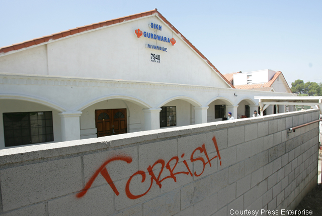 The boundary wall of the Sikh Gurdwara of Riverside that has been spray-painted with words `TERRORIST' and ``TERRISH' in what is an obvious case of a hate crime