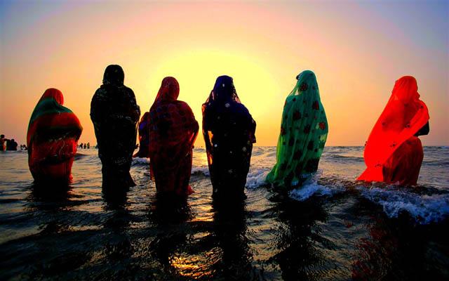 Hindu devotees at sunset