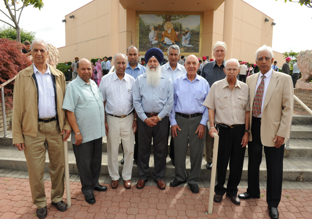 Indian Cultural Centre office-bearers pose in front of the building