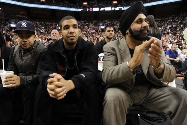 Nav Bhatia watching an NBA game in the company of Canadian rapper-actor Drake.