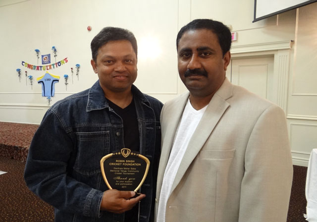 Arun Layam with the recipient of special plaque