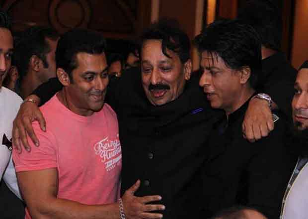 Shahrukh and Salman pose with Bab Siddique after hugging each other at the Baba's Iftar party in Mumbai on Sunday