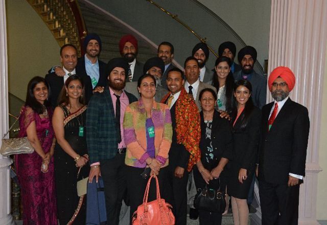 Sikhs presenting Punjabi phulkari to White House official at the event