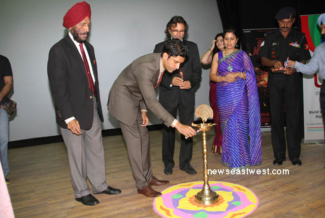 Actor Farhan Akhtar, who plays the role of Milkha Singh the film, lights the tradition lamp at the special screening of the film for Indian Army jawans in Chandigarh cantonment.