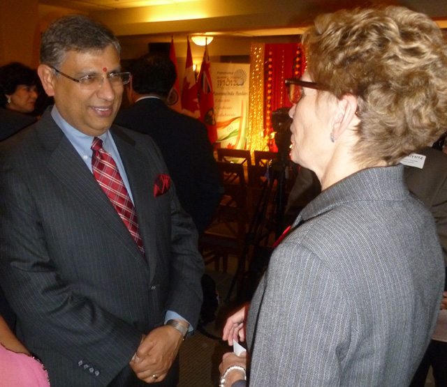Suresh Madan seen with Kathleen Wynne