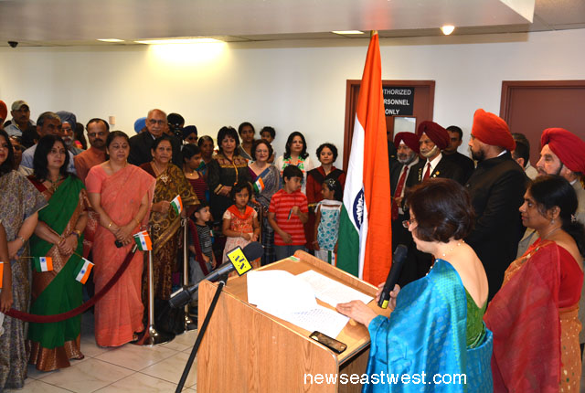 Consul General Preeti Saran reading the President's message. To her right is Consul D Charandasi.
