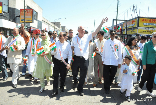Illinois Governor Pat Quinn walking during the India Day parade  and waving to the crowds in Chicago on August 17.