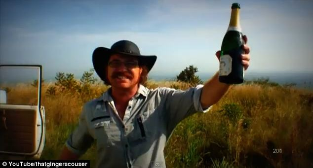 Graham Hughes celebrates the end of his travels when he crossed into South Sudan in December 2012