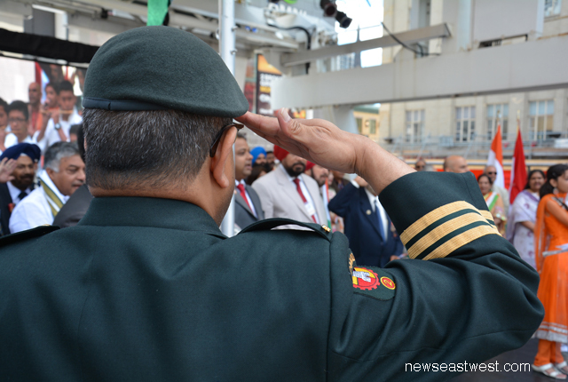 Hon. Lt Col Hari Panday saluting the Indian flag at the India Day opening ceremonies.