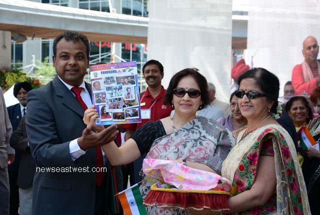 Indian consul general Preeti Saran (middle) unveiling the Panorama India souvenir. To her right is Panorama Chair Jibanjit Tripathy.