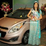 Miss India Canada 2013 Harleen Malhans with her Chevrolet Spark award