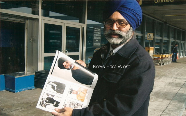 New-York-Sikh-Rajinder-Singh-Bammi-showing-his-picture-in-the-New-Yorker-after-the-attack-on-him-in-2004 copy