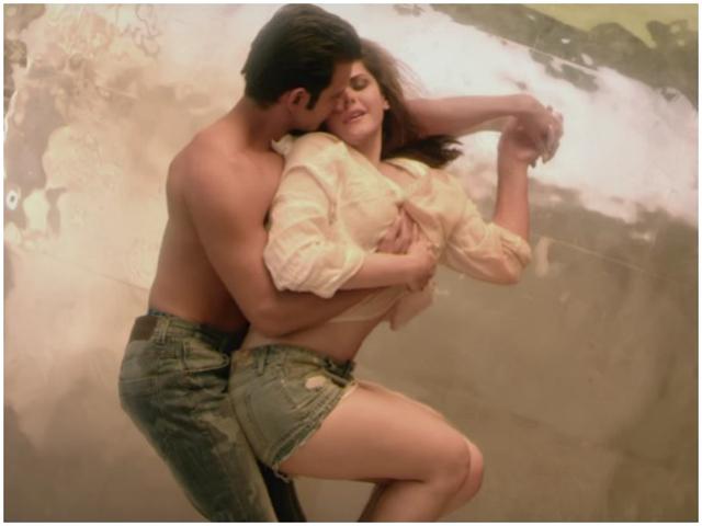 Zarine Khan in the arms of Karan Singh Grover