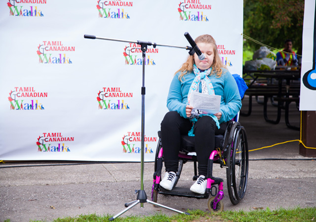 Emma Hill, a patient and ambassador from Holland Bloorview, speaking at the walk-a-thon